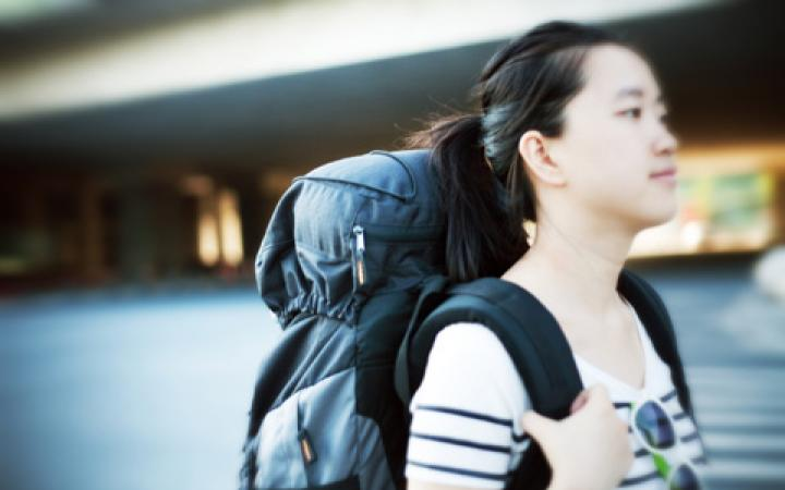 Student carrying a travel backpack