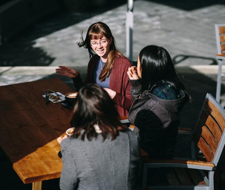 3 female students at outdoor cafe