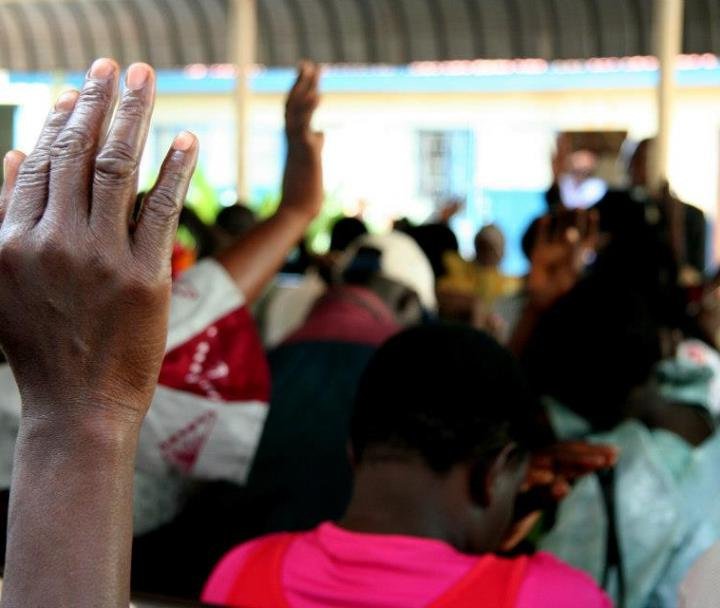 Hand raised in African community meeting