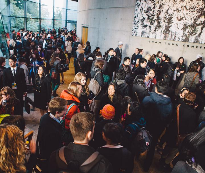 A crowd of people in the Chan Centre reception area
